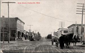Clarksville Michigan~Dirt Main Street~Marvin Hardware~Man w/Loaded Wagon~c1910