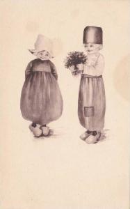 Dutch boy gives flowers to Dutch girl, 10-20s