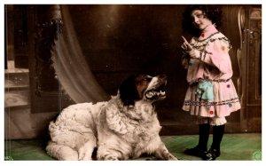 Dog ,Saint Bernard with young girl