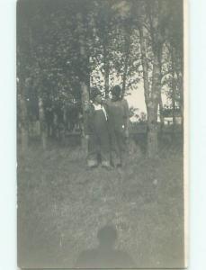 circa 1910 rppc POSSIBLE GAY INTEREST - MEN IN OVERALLS HUGGING o2701
