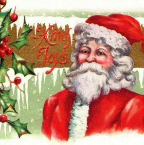 c 1909 Red Coat Santa St Nick Snowy Banner Holly Berries Postcard
