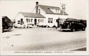 Breen's Cabins Katrine Ontario White Rose Gas Pumps 7up Coke RPPC Postcard E62