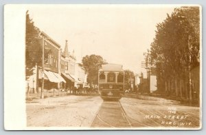Kiel WI~Main Street Fantasy~Big Trolley Runs Past Stores~Dirt Road~1908 RPPC