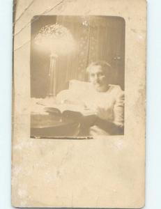 Pre-1918 rppc ANTIQUE LEADED GLASS LAMP BY WOMAN READING BOOK HM0176