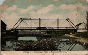 Johnsonville WI~Single-Span Truss Bridge on Sheboygan River Between Barns~c1910
