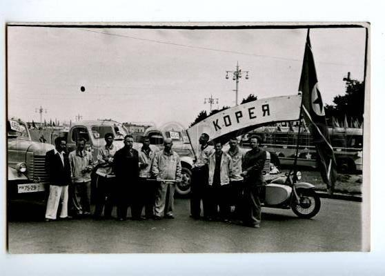 172957 KOREA delegation in Russia flag motorcycle old photo