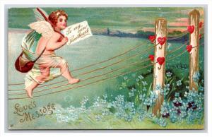 VALENTINE  Cupid walking on fence