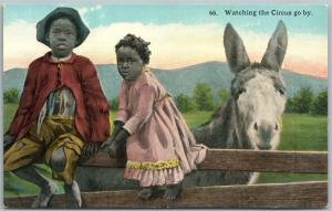BLACK AMERICANA WATCHING THE CIRCUS GO BY ANTIQUE POSTCARD