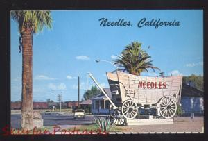 NEEDLES CALIFORNIA ROUTE 66 1950's CARS COVERED WAGON SIGN