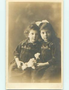 Circa 1910 rppc PRETTY GIRL WITH BOW IN HAIR WITH LITTLE SISTER r6725