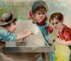 1893 Midsummer Lion Coffee Woolson Spice Co. Children Sharpening Axe #1 *D