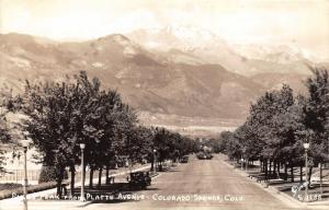 Colorado Springs Colorado~Platte Avenue~Man under Trees~Pikes Peak~40s Cars~RPPC