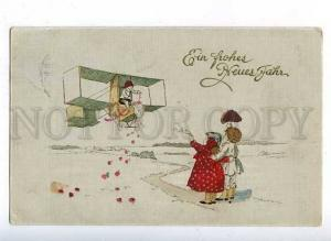 184802 NEW YEAR Cute Kids on PLANE Biplane Vintage color PC