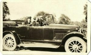 Group of People in an Old Car of Unknown Brand (1920s) RPPC Postcard