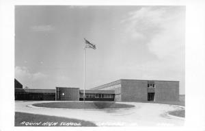 Cascade IA ~Flag Waves  @ Aquin High School~RPPC c1950 Rasmussen of Lost Nation