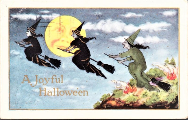 A Joyful Halloween Post card with 3 witches on brooms