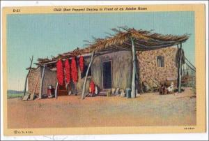 USA - Southwest. Red Peppers Drying, Adobe Home