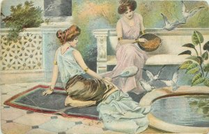 Glamour ladies feeding doves early postcard