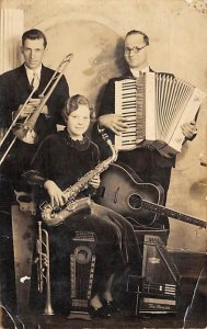 a woman and 2 men playing instruments Music Unused
