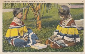 Seminole Indian Girls Stringing Beads , Miami , Florida , 30-40s