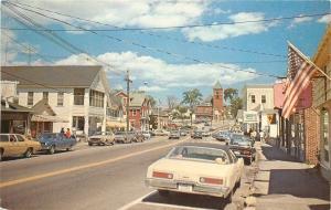 Wolfeboro New Hampshire~Main Street~Pharmacy~Flag~1970s Cars~Postcard