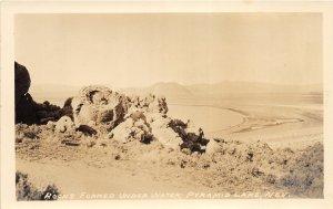 F88/ Pyramid Lake Nevada RPPC Postcard c1930s Rocks Formed Water