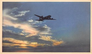 Silhouetted against a late afternoon sky ADC – six United mainliner 30...