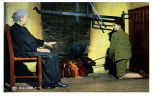 15044  Irish Woman  1910   Grandmother teaching boy stoking fire