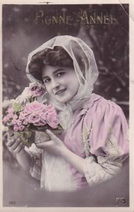 RP: NEW YEAR, 1900-10s; Portrait of woman, scarf covered head, holding plante...