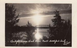 RP: Battleford , Saskatchewan , Canada , 30-40s ; Bridge at Twilight