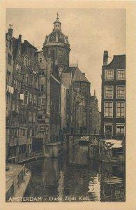 Netherlands Amsterdam Oudezijds Kolk narrow canal in city center  Postcard