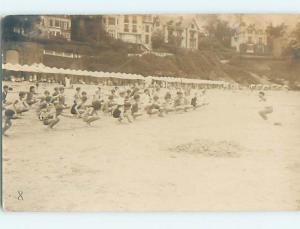 c1910 rppc MANY KIDS EXERCISING ON THE BEACH SHORELINE HM0900