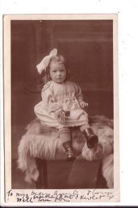 Real Photo, Little Girl with Big Bow Sitting on Fur, Used 1921