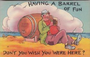 Humour Man With Beer Stein and Keg On Beach Having A Barrel Of Fun