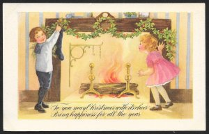 To You May Christmas with its Cheer... Boy Girl Holly Fireplace Unused c1910s