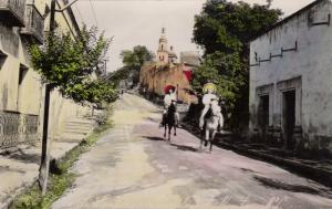 RP: MONTERREY , Mexico , 1921 ; Riding donkeys on Street