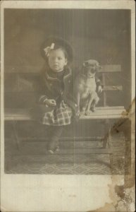 Little Girl on Bench Posing w/ Dog Mixed Pug Breed? c1910 Postcard
