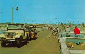 Oceanside California fisherman visitors on concrete pier vintage pc ZA440486