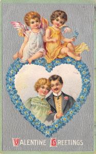 Victorian Valentine~Couple in Forget-Me-Nots Heart~Cupids on Top~Emboss~Silver
