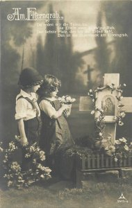 Children couple praying at the parents grave Am Elterngrab early postcard