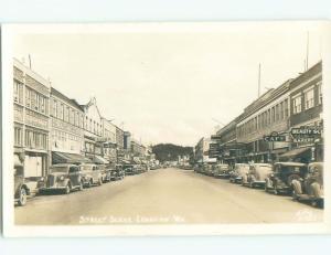Pre-1950 rppc SHOPS ALONG STREET Longview Washington WA W0392