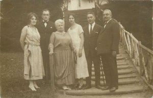 elegant ladies and gentlemen family picture Post card