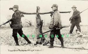 1909 Exaggeration Real Photo Postcard: Rabbit Hunters With Their Catch