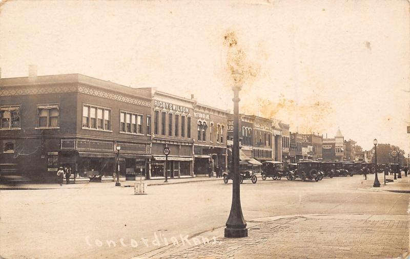 Concordia KS~Rigby & Wilson Funeral Home & Appliances~Austin Dry Goods~1907 RPPC
