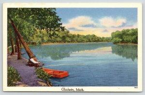 Gladwin Michigan~Man Fishing From River Bank~Red Flatboat~1940s Linen Postcard