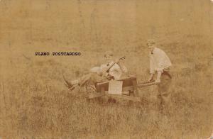 KIDS PLAYING GUITAR IN WHEELBARROW- EARLY 1900'S  RPPC REAL PHOTO