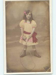 c1910 rppc foreign CUTE GIRL PLAYING WITH ANTIQUE STRING TOY HM1356