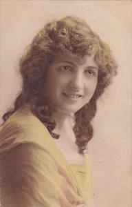 Portrait of pretty woman wearing yellow gown, 00-10s