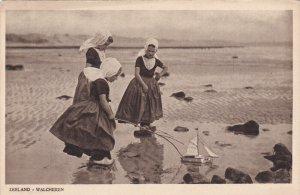 ZEELAND, Netherlands; Walcheren, Dutch Girls playing with toy sailboat, 00-10s