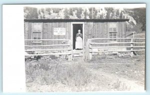 RPPC  Location ?? ~ EARLY CABIN Woman & Sign ROOT BEER FOR SALE c1910s Postcard